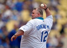 Sean O'Brien throws out the ceremonial first pitch prior a baseball game between the Los Angeles Dodgers and the San Diego Padres (AP Photo/Mark J. Terrill)