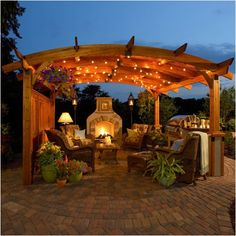 Ooooh Yes! - The Outdoor GreatRoom Company Sonoma Arched Wood Pergola in Redwood Stain | Wayfair