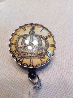 ID badge /tag reel Steampunk crown by TheModernVictorian on Etsy, $10.00 https://www.etsy.com/listing/179292258/id-badge-tag-reel-steampunk-crown?ref=listing-shop-header-3