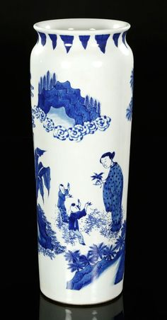 """Blue and white porcelain vase, China, 17th century, elephant leg form, decorated with children playing in the garden, 17 1/2""""."""