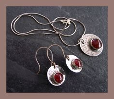 Sterling Silver and Carnelian Pendant and Earrings £40.00
