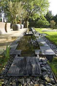 Fontaine et bassin maçonné sur mesure en ciment noir et dallage d'ardoise at Le Mas desIsords in Provence by Gerard Faivre