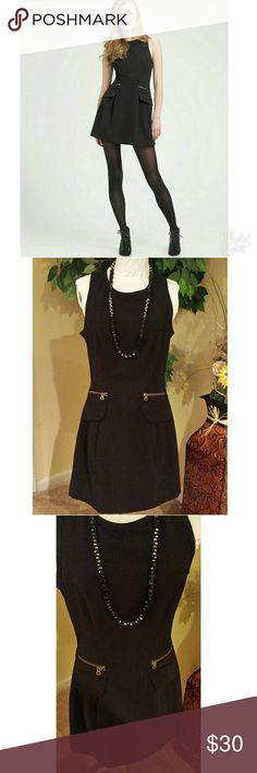 """🎀Nanette Lepore Little Black Dress Very classy black dress with some stretch, two zipper pockets and two illustration pockets with flaps. Very simple but beautiful, the back has a chunk copper  21.5"""" long zipper dress also has a polyester lining on the inside.   Size 4 L 34"""" W 15"""" Nanette Lepore Dresses Midi"""