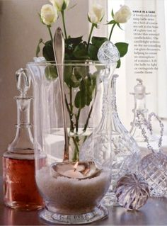 clever...pretty vase with course sea salt, old ladle and a small candle