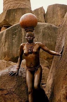 Nuba girl of Kau, Sudan. Photo by Leni Riefenstahl, 1970's