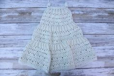 Crochet tiered baby dress.