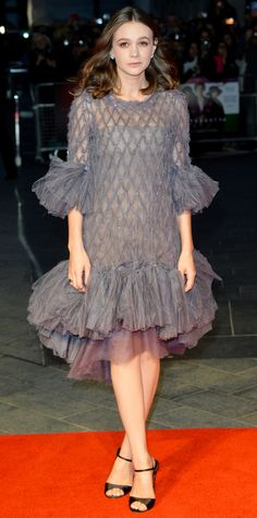 Carey Mulligan dialed up the drama for the Opening Night Gala at the BFI London Film Festival in a statement-making sheer gray Chanel Couture number with oversize frills at the hem and studded latticework detailing. She downplayed her accessories, with simple diamond studs and black sandals.