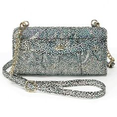 """Juicy Couture Pasha Convertible Wristlet Juicy Couture Pasha Convertible Iridescent Black Wristlet. With the Iridescent finish and curb-chain accent, this Juicy Couture convertible wristlet will be your new favorite.  4""""H X 8""""W X 1""""A  Approx. drop down length: 23"""" Adjustable/Removable Crossbody Strap  Zipper closure  Exterior: 2 zip pocket  Interior: 2 slip pockets & 12 card slots  Faux Leather Juicy Couture Bags Clutches & Wristlets"""