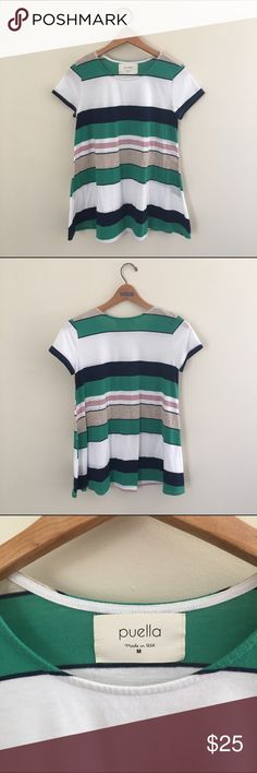 Puella Anthropologie striped swing tunic Very cute multicolored striped swing tunic by Puella. Shades of white, green, navy blue, red, and beige. Loose fit. In good condition, but does show some minor wear. Please see up close photos. There is still lots of life left in this top. Would look very cute with leggings and boots. Anthropologie Tops
