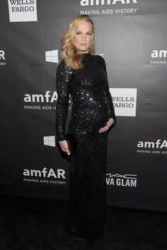 Molly Sims.. Ruffian sequin gown, Rauwolf clutch, Neil Lane jewels, and Stuart Weitzman pumps..