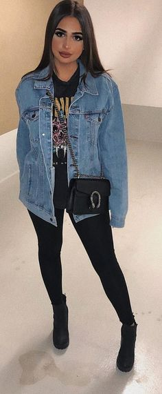 #spring #outfits woman wearing denim jacket, crossbody bag, shirt, leggings, and pair of heeled boots. Pic by @xoxomerve