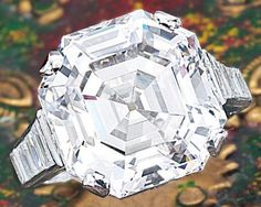FINE DIAMOND RING, CIRCA 1931, Cartier. The ring simply set with a square emerald-cut diamond weighing 14.43 carats, flanked by single-cut and tapered baguette diamonds together weighing approximately 1.20 carats, mounted in platinum. Sotheby's.