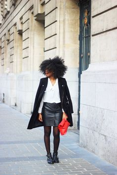Black coat White shirt Leather skirt Cut out boots Red bag  Kinky curly