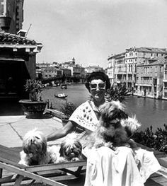 Superwoman Peggy Guggenheim with her dogs on the roof of her Venetian Palazzo, 1950 Photo by David Seymour