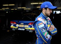 """Chase Elliott Photos - Chase Elliott, driver of the #24 NAPA Auto Parts Chevrolet, stands in the garage area during practice for the NASCAR Sprint Cup Series Axalta """"We Paint Winners"""" 400 at Pocono Raceway on June 3, 2016 in Long Pond, Pennsylvania. - Pocono Raceway - Day 2"""