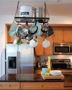 I keep coming back to a pot rack as a way to help with my limited kitchen storage. I need to just bite the bullet and do it. I like this one...