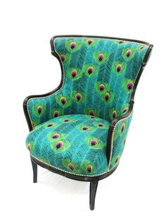 Check out this fabulous antique wing chair reupholstered in an embroidered peacock fabric!