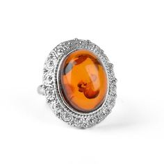 """""""Grandiose Amber Cocktail Ring Item No. AM03317A01 $83.99 This exceptional size 7 ring features a large and genuine Russian honey amber stone, approximately 5/8"""" long and 1/2"""" wide. The naturally beautiful gem is situated in a stylized border of sterling silver. This grandiose ring is an excellent jewelry option for anyone who loves cocktail rings!"""" Amber Stone, Amber Jewelry, Naturally Beautiful, Baltic Amber, Cocktail Rings, Gemstone Rings, Cocktails, Honey, Sterling Silver"""