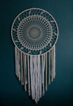 This stunning large dream catcher wall hanging is a beautiful statement of the bohemian style. The crochet part of the dream catcher took about a week to make, this bohemian wall decor has a magnetic energy of a handmade item.  I imagine this giant dream catcher on the top of