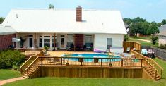 "above ground round pool - love how the deck surrounds it entirely and is continuous with the ""back porch"""