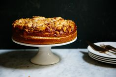 This bee sting cake recipe is filled with pastry cream and topped with almonds and we're in love (via Food52)