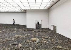 """Olafur Eliasson fills modern art museum with """"giant landscape"""" of rocks."""