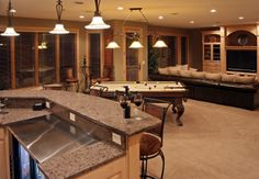 basement. just take out the pool table and carpet and add beer pong table and wood floors.