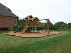 This is basically what I want to do with our smaller play set in our smaller yard...mulch is the way to go!  No toxic fumes from recycled tires.