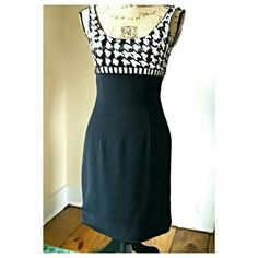 Sequin Beaded Little Black Dress This beautiful little black dress has a sequined and beaded bodice that is so striking.  It has a back zipper closure.  The label is Niteline Della Roufogali and is size 2. Niteline Dresses