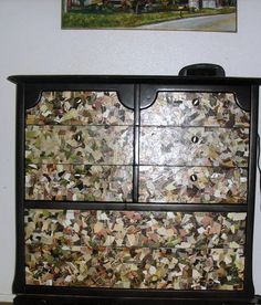 Refurbished Kevin's super old, ugly dresser by spray painting it black and giving the drawers a camo feel with mod podge and ripped magazine pages.