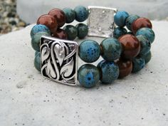 A beautiful handmade bracelet that has a Bohemian vibe and is a great addition to your summer wardrobe./ Really like the silver leaf square. Wire Jewelry Earrings, Diy Necklace Bracelet, Charm Jewelry, Bangle Bracelets, Beaded Jewelry, Diy Jewelry Inspiration, Bracelet Designs, Summer Wardrobe, Handmade Bracelets