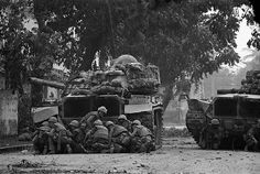 South Vietnam- US Marines take cover behind a tank in Hue after Viet Cong terrorists snipers opened fire on them. The Marines, along with the South Vietnamese troops, were battling an estimated Viet Cong who occupied parts of this ancient, Imperial city. Military Girlfriend, Military Humor, Military Love, Military History, Military Spouse, Military Service, Hue Vietnam, South Vietnam, Vietnam History
