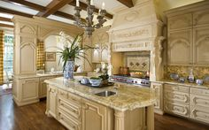 Cook's kitchen with large island, Wolf stove & oven, in a French Classical House in Highland Park, TX. French Architectural designs by Richard Drummond Davis Architecture.