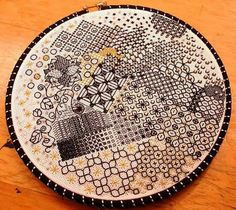 Isn't this blackwork sampler by Megan Congdon just all kinds of delightful? She's played with different weights of thread to create shadows and interest. Plus, Megan added in touches of gold thread and beads. Image courtesy of http://colored-thread.blogspot.ca/2010/11/stitch-and-surface-finale.html