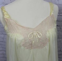 Youll be so ready to have the girls over for a slumber party, and when someone yells pillow fight youll bring it on with style and fun in this amazing yellow nightie. The shear cover flows about you to make you feel like you are floating on air, and the nylon underneath keeps your