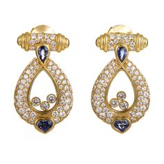 Chopard Happy Diamonds Sapphire Gold Drop Earrings | From a unique collection of vintage drop earrings at https://www.1stdibs.com/jewelry/earrings/drop-earrings/