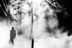 Trent Parke AUSTRALIA. Sydney. An office worker on his way to work walks through Martin Place. From Dream Life/series. 2001.