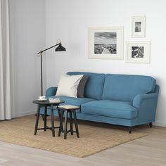 Refresh your home - STOCKSUND Sofa, Ljungen blue. A real showpiece with tailored cover available in different textures, sewn with piping and pleats. Turned wooden legs add to the detail. Brown Wood, Black Wood, Ikea Stocksund, Design Ikea, Ikea Family, Sofa Legs, Sofa Frame, Fabric Sofa, Seat Cushions