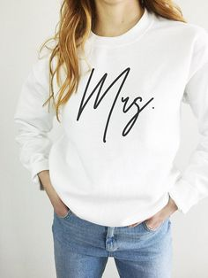 cotton and polyester blend with black modern script out type on a crisp white unisex sweatshirt.Features:○ Blend○ Heat Transfer Vinyl ○ Eco Shipping○ Handpressed With All My LoveThanks a heap for shopping small 💛Kristen Mrs Shirt, Bridal Shower Gifts, Bridal Showers, Squad, High Wasted Jeans, Future Mrs, Shower Outfits, Bride Shirts, Closets