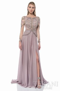 Long sleeve mother of the bride dress with linear beaded, lace accented bodice and peplum and a long foil chiffon skirt finished with a slit.