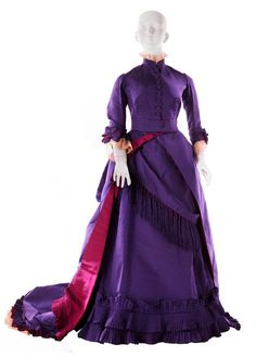 Worth afternoon dress ca. 1876. I don't think I've ever seen a color that bold and bright in a 19th century dress. I wonder if it was considered ostentatious at the time.