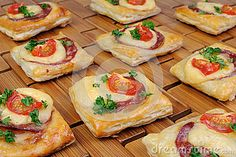 Appetizer of puff pastry with salami, cheese and cherry tomatoes