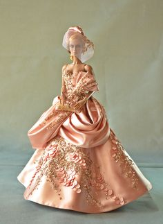 https://flic.kr/p/kEeEA4 | EnTrance I | OOAK Couture of Blush colored Satin draped ball gown, hand applied micro spangled lace, hand beaded with gold cutglass and faux pearls. Corset back, though its fitted with Numina Body, fit could adopt to similar sized dolls like Deva and Jamieshow, fit may be awkward for Sybarites but tolerable. Includes Ball Gown, Headpiece which is permanently attached to the wig, beaded purse and petti coat underneath. for details on how to bid, got to my blog…