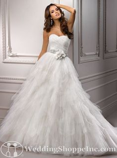 Usually I'm not a big ruffles fan...but I like this Maggie Sottero-Carissa