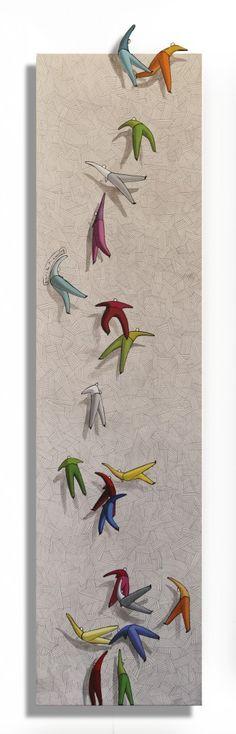 """Personaggi immaginari nati dalla fantasia (...) Si inseguono, si sorpassano, si  rendono per mano, rotolano verso l'ignoto, sono sereni, divertiti, catapultati nel mondo dei sogni. Sono gli """"omini"""" di Daniele Misani [Roberta Filippi] http://artemirabilia.com/artista/daniele-misani/ [Daniele Misani, n.serie112 - serie Coordinate Spaziali - 110x30cm mista su tavola - 2012]"""