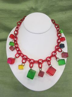 """Cheerful-looking vintage Bakelite & celluloid """"jello cubes"""" necklace ... great to wear with a summer sundress."""