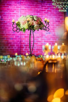 Scrolled wrought iron candelabra with peonies, peonies and more peonies, Nancy Saam Flowers                                  Venue: Tendenza, Philadelphia                  Photo Credit: Hoffer Photography