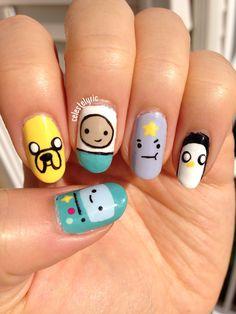 Adventure time nail art.  Thumb:BMO  Index:Jake  Middle:Finn  Ring: Lumpy space princess  Pinky:Gunter