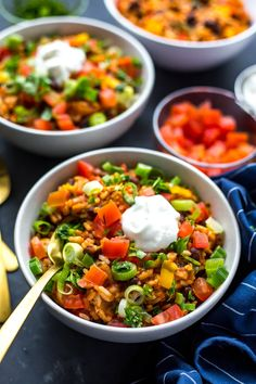 These 20-Minute Instant Pot Chicken Burrito Bowls are a delicious, healthy quick dinner or meal prep idea using mostly pantry staples - read on for a slow cooker option!