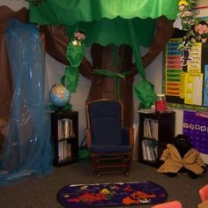 Classroom decoration. The Rainforest- Turn our storage cabinet into a tree. love the paper hanging from the ceiling like foliage